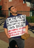 Protest: Edward Elisada, a bodyguard who knew Thomas, advocates for police surveillance. Photo by Josa Lamont