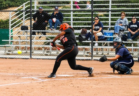 Daisy Sanchez/ Staff Photographer Slugger: RCC's Breanna Valles holds nothing back as she singled off a pitch against Golden West College.