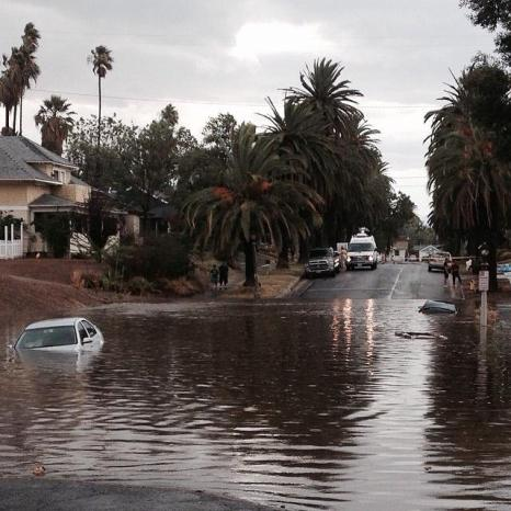 Vehicles submerged in water on Lime Street following the Storm on Sept. 7 in Downtown Riverside. (Courtesy of Dori Cameron)