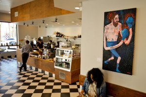Photo by John Villanueva On Display: Geoff Gouveia's art hangs inside of  Augie's coffee house on 12th St and Lemon St. in downtown Riverside. A mural also adorns the wall facing 12th St.