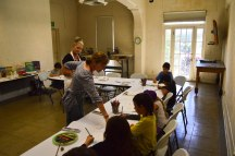 Kelly Rider teaches children art in the Riverside Art Museum with the assistance by Sally Mazzetti.