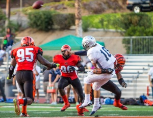 DEFENSE: Sophomore Linebacker Jonah Moi breaks through the offensive line for a breathtaking tackle against El Camino College quarterback Joey Notch on Oct. 4.