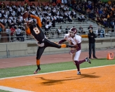 TOUCHDOWN: Isaac Whitney completes the pass and scores a touchdown for RCC at the state semifinals held at RCC on Nov. 29, 2014. (Michael Walter | Asst. Photo Editor)