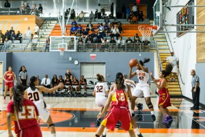 luis solis/  Photo editor rebound: Tigers foward-center No. 42 Tori Mitchell catches a rebound off the opponents rim College of the Desert during the opening round of its Inaugural Earning Our Stripes Tournament.