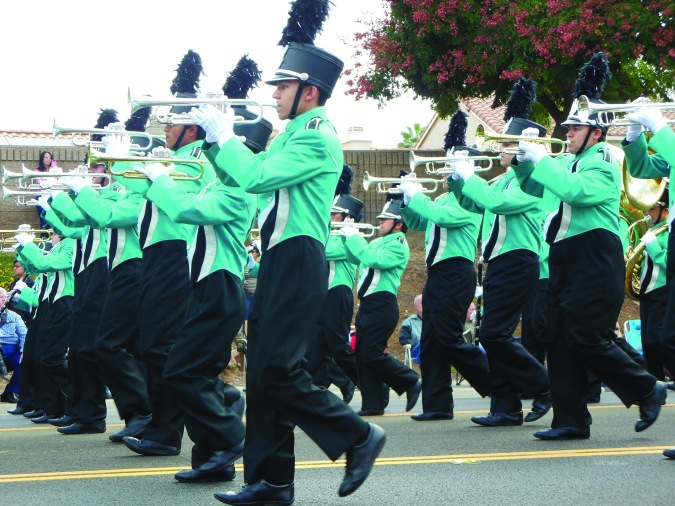 "Santiago High School Marching Band and Color Guard perform ""The Klaxon"" on Cole Avenue in Riverside on Oct. 18."
