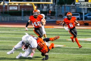 Luis Solis | Photo Editor Contender: Members of the Riverside City College defense swarm toward the El Camino Warriors' ball carrier in the the Central League opener Oct. 4. RCC is 5-0 against league teams.
