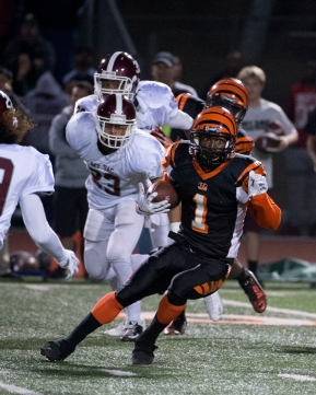 RUN: RCC's wide receiver Alejandro Marenco makes a desperate attempt to gain ground against Mt. SAC at the state semifinals held at RCC on Nov. 29, 2014. (Michael Walter | Asst. Photo Editor)