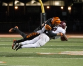 AIR BOUND: RCC defensive back Terin Solomon of RCC takes Mt. Sac's wide receiver Aaren Vaughns off his feet with an incredible tackle at the state semifinals held at RCC on Nov. 29, 2014. (Michael Walter | Asst. Photo Editor)