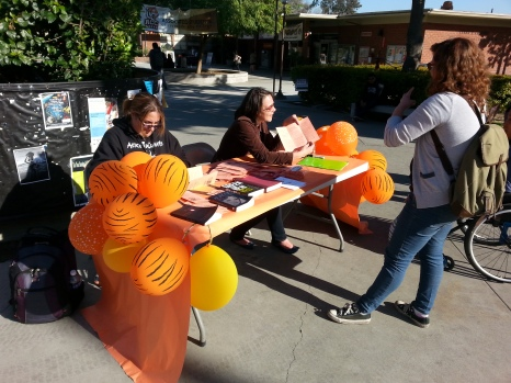 RCC part-time instructor Jacquelyn Bang (center) informs students Angela Williams (left) and Synnora MacLeod (right) about Adjunct Walkout/Awareness Day. Jacob Filek | Viewpoints