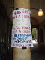 A poster addressing homophobia hung in the entry gates of the Quadrangle during the Gender and Sexualities Alliance Rally May 26. Crystal Olmedo   Viewpoints