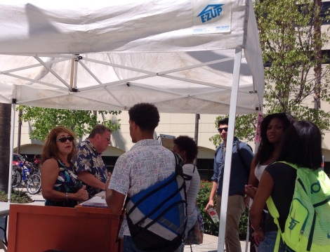 Terry Welker, RCC library administrative manager and Steve Brewster, librarian answer students' questions at the information at the booth on Terracina Drive on Aug. 31.