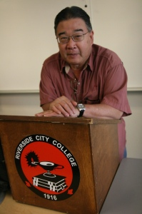 Ron Yoshino, RCC professor emeritus, stands behind a lectern he taught from during his time at the college.