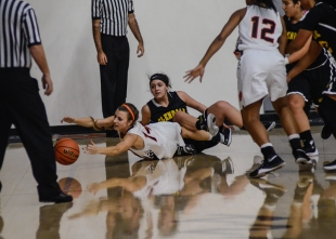 Kylie Stevenson, guard for the Tigers' dives for the ball after falling to the floor with Glendales player, Mary Karapetyan on Nov. 13.