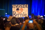 Bernie Sander's supporters hold up Riverside sign with peace heart in the Riverside Municipal Auditorium on May 24, 2016.