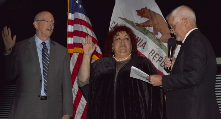 Newly elected board members being sworn in by Micheal L. Burke Chancellor during a ceremony at 3801 market street riverside, Ca 92501 on Nov 29, 2016 at 5:30 p.m